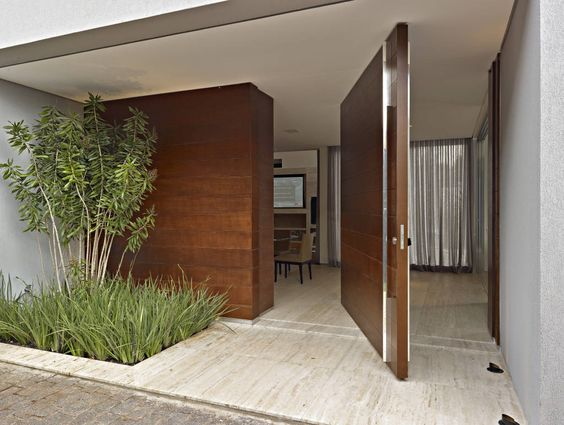 Puertas principales para casas modernas for Doble puerta entrada casa