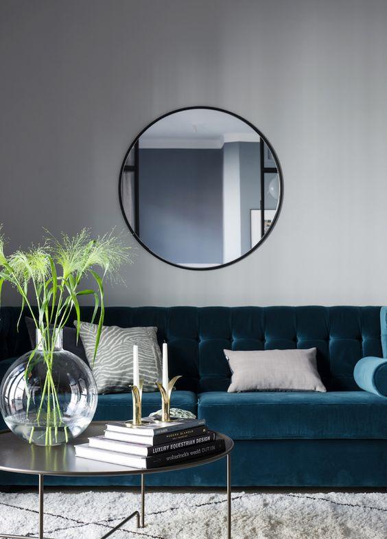 Decoración de salas con espejos redondos