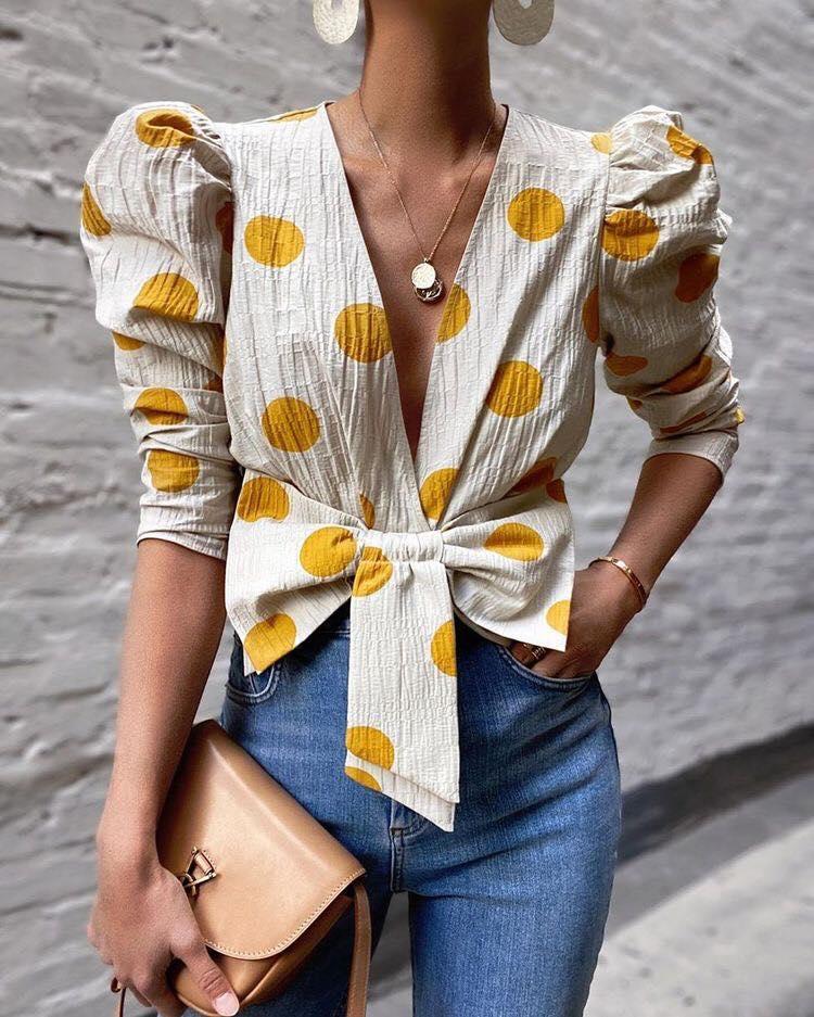 Moño y mangas bombachas para estilo de blusas de moda